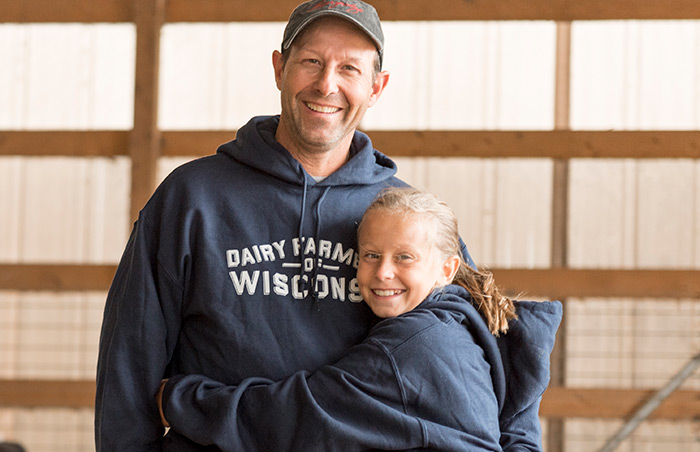 Dairy Farmer and Daughter in Barn